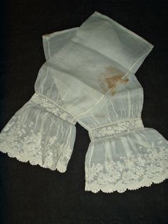 """Antique Mid Victorian 1860's Civil War Pair Whitework Embroidery Under Sleeves   eBay seller maklinens, completed hand stitched with one seam construction, slights ruffled cuffs measure 7"""" wide, cuff edge, at the wrist - 19"""" around; width at top of sleeve: 8"""" (16""""circumference); sleeve length: 20-1/4"""""""