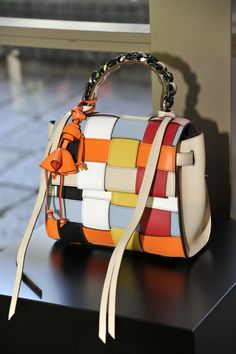 Recalling a Rubik's Cube, Elena Ghisellini interwove multicolor leather straps, injecting a playful feel in her beautifully crafted bags, which showed graphic and sophisticated silhouettes. — Alessandra Turra