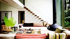 4 All-Star Brazilian Homes Worth the Trip // modern architecture, striped fabric, pillows, leather side chair, fireplace