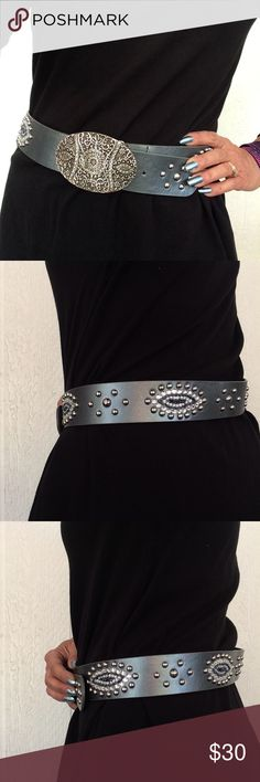 "CHICOS LEATHER BLING BELT EUC Chicos grayish silver leather belt. Gorgeous silver studded dots mixed with crystals and beading on this stunning on trend belt. Like new only worn a few times.  Belt holes are at 35"", 36"", 37"", 38"", 39"". No missing stones or beads. Embellishments are riveted to leather. No defects or flaws. Chico's Accessories Belts"