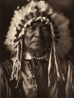 Arikara man, Sitting Bear. Photographed by Edward S. Curtis, 1908.
