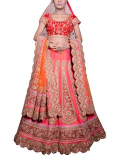 This magnificent red lehenga by Saroj Jalan embodies grandeur and will make you look like a queen! The all over intricate antique cutowork detailing on the lehenga is nothing but spectacular. It has been teamed with a red velvet blouse with all over rich golden embroidery and red scalloped border at the sleeves. The embellished red net dupatta and stole finish this regal look beautifully.