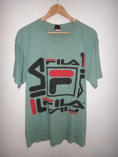 accd0c6b102 On Sale 25% Off Rare Vintage Fila Hip Hop Swag T Shirt Rap Made in Usa  Tennis Big Logo Nice Design F