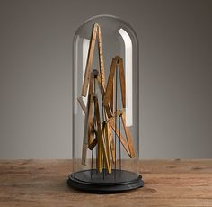 "Restoration Hardware - Vintage Folding Measures in Cloche $395 Mounted on iron posts and displayed beneath a blown-glass cloche, a collection of folding vintage measures has the visual impact of art.     9½"" diam., 21""H     Weight: 10.5 lbs."