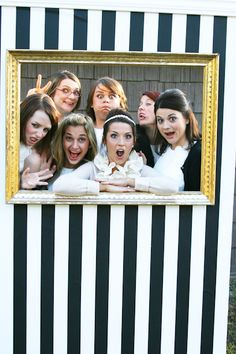 Great Idea for Photo Booth - Frame in opening of decorated plywood and let guests do the rest!