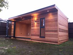Horizontal red cedar cladded room with bi-fold doors. Cedar Cladding, Tiny House Community, Red Cedar, Craftsman, Shed, Home And Garden, Outdoor Structures, Doors, Serenity