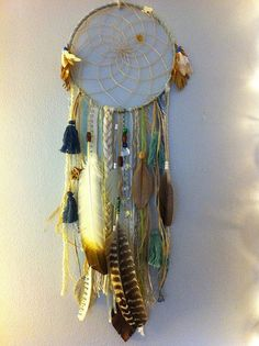 This one is closer to the usual dream catchers. It has loops of strings in the center and feathers, tassles and every day trinkets dangling where the dreams will flow.