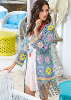 94b98228b2b Light and airy long crochet cardigan made with colorful floral squares.  Full pattern in chart form.