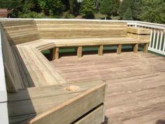 Maybe this style bench on the deck. Needs under seating storage though.