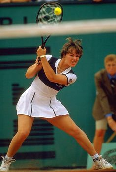 Martina Hingis going for a backhand winner against Iva Majoli during the 1997 French Open Final. Despite coming into the final on a record 37 match winning streak, the Swiss World Number One was no match for the ninth-seeded Croatian who won 6-4 6-2. (Photo: Heinz Kluetmeier/SI)