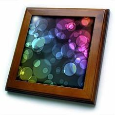"""Abstract Circles of Light - enjoy this colorful abstract graphic design of Boken light - 8x8 Framed Tile by Perkins Designs. $22.99. Dimensions: 8"""" H x 8"""" W x 1/2"""" D. Inset high gloss 6"""" x 6"""" ceramic tile.. Solid wood frame. Cherry Finish. Keyhole in the back of frame allows for easy hanging.. Abstract Circles of Light - enjoy this colorful abstract graphic design of Boken light Framed Tile is 8"""" x 8"""" with a 6"""" x 6"""" high gloss inset ceramic tile, surrounded by a s..."""