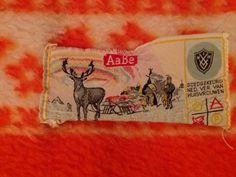 Logo van AaBe, ik heb enkele dekens in mijn bezit. Soms kun je ze ook nog in tweedehands winkels vinden.