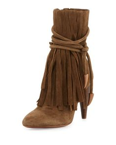 "Ash suede bootie with long fringe trim. 4"" stacked heel; 9.5""H shaft, 10"" circ. Almond toe. Wraparound ankle strap. Side zip eases dress. Padded footbed. Leather lining and sole. ""Bird"" is imported."