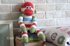 "Free monkey amigurumi pattern. The monkey resembles the look of the popular Sock Monkey. It measures 18"" tall, great as a cuddly soft toys for kids."