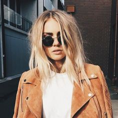 ::tan suede jacket, dark round sunglasses  effortless messy hair. loving the 70s vibes::