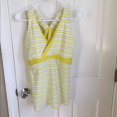 Lululemon Deep V Tank Size 10 Lululemon workout top in good condition- some yellow marks near hems on shoulders and one other small mark as shown in the pictures. Back is mesh. Just purchased here and it's too big! Looking to get back what I paid for it. lululemon athletica Tops