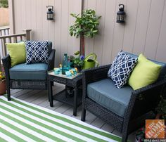 Small Deck Decorating Ideas:  Hampton Bay Fenton Chat Set with Green Striped Outdoor Rug, Potted Plants and Colorful Throw Pillows