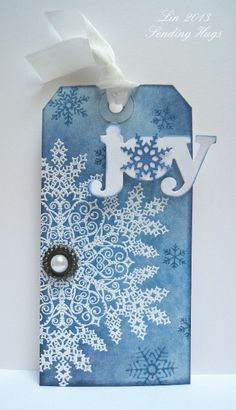 handmade Christmas tag ... Snowflake Joy by bearpaw  ... luv the sponged blues with huge embossed snowflake ... cute die cut JOY with snowflake O ... great tag!!