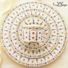 """""""Recamier"""" shape with stylized flowers and mat gold filet."""