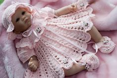 Free Crochet Baby Dress Patterns | This Sweet As a Rose outfit consists of a dress, bonnet & booties. It...