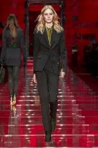 """For the brand's fall-winter 2015 collection, Donatella Versace looked to the internet for inspiration. The result was an outing of colorful and bold clothing with sexy cut-outs, color-blocked pieces and crazy prints prominently featuring the house's Greek key–essentially things that would pop in today's fast-paced, social media driven world. As the press release noted, """"This …"""