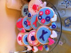 Sugar cookies with royal icing and fondant appliqués.