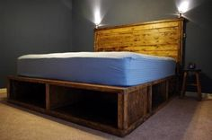 King size storage bed... Mike is so gonna build this for us! I can see it know with super cute wicker baskets under it!