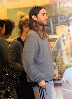 Fast-food patron: Wearing his ombré tresses down, Jared covered his slim, 5ft9in frame in a very casual grey jumper and Adidas sweatpants for the outing