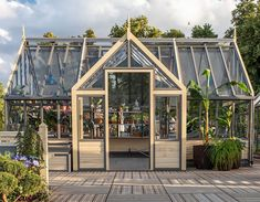 Superior Quality Greenhouses by Design | UK | Cultivar Greenhouses Greenhouse Cost, Outdoor Greenhouse, Greenhouse Gardening, Greenhouse Ideas, Wood Greenhouse Plans, Farmhouse Greenhouses, Wooden Greenhouses, Contemporary Greenhouses, Little Green House
