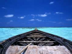 Small Fishing Boat (Dhoni) in the Crystal Clear Waters off the Maldives, Maldives;   by Dennis Wisken