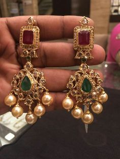 Gold Ruby Emerald Earrings from PSJ – jewelry Gold Jhumka Earrings, Gold Earrings Designs, Gold Jewellery Design, Emerald Earrings, Necklace Designs, Antic Jewellery, Bridal Earrings, Ring Designs, Gold Necklace