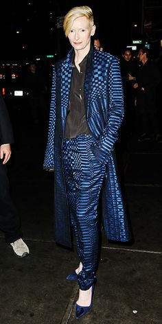 TILDA SWINTON Never one to follow the norm, fashion-wise, Swinton stood out in a Haider Ackermann ensemble, consisting of a long blue-and-black checkered coat and matching pants, paired with a black blouse and blue pumps.