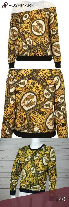 TOPSHOP ANIMAL TIGER SWEATSHIRT PULLOVER SWEATER TOPSHOP ANIMAL TIGER SWEATSHIRT PULLOVER BLACK YELLOW LADY GAGA SIZE 6 SWEATER  Condition: GOOD CONDITION. SEEN LADY GAGA WORE THE SAME DESIGN IN FIVE FOOT TWO.   Measurement  Armpit to armpit: 18.75 Bottom armpit to wrist: 19  Back of the neck to bottom hem: 22.5 Topshop Tops Sweatshirts & Hoodies