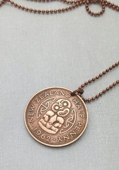 Pendant made from a vintage copper coin from New Zealand featuring Hei Tiki. Patinaed copper coin, I polish to Penny Necklace, Coin Necklace, Maori Designs, Coin Jewelry, Jewelery, Nz Art, Maori Art, Kiwiana, Leather Cord