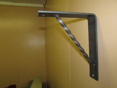 This is Hand made in Carolina Custom Iron.Com Shop, A Heavy Metal Bracket approximately 9 x 9  made of 1/4 x 2 flat bar with twisted 1/2 bar.