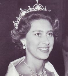 Princess Margaret wearing the Lotus Flower tiara. Originally owned by the Queen Mum, this tiara was one of Margaret's favorites, and has most recently been seen on Duchess Kate