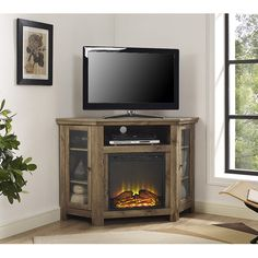 Utilize your corner space with this 48' wood media stand with electric fireplace. Its corner design makes this the perfect space saving unit while creating a warm, entertaining space in your home. Cra