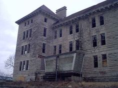 Bartonville Insane Asylum (1885-1972). Reports of activity include apparitions of patients dressed in gowns wandering the halls, cold spots and overall heavy atmosphere. (Nurses Dorm pictured)