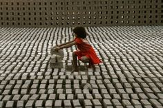 This world isn't a perfect bubble - A young girl stacks bricks at a brick factory in Hyderabad, India. (Photo CREDIT: Krishnendu Halder)
