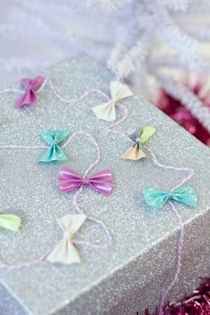 DIY Duct Tape Bow Gift Garland - wonder if this would work with scrapbook paper? So cute!