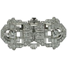 Mauboussin Art Deco Diamond Gold Platinum Double Clip Brooch. An Art deco diamond double clip brooch, by Mauboussin circa 1925. Of geometric design, set with old cut and baguette-cut diamonds, mounted in platinum and yellow gold. Signed Mauboussin