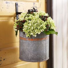 Hang a bucket of flowers