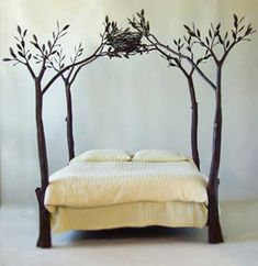 feathering your nest, so to speak. treetop canopy bed with birds nest. nature-inspired design