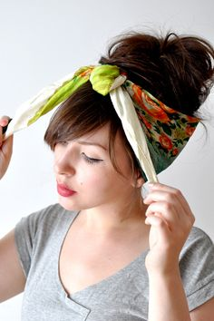 tying a head scarf...might have to get a little more body in my hair for this one, but love it!