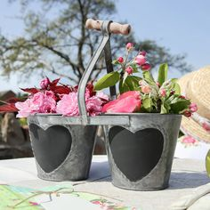 Galvanised zinc herb or house plant double pot planter with a wooden decorative handle to top for carrying. Heart shape chalk area to front for personalising contents
