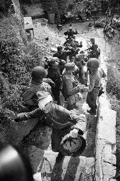 U.S. Army soldiers of the 3rd Brigade, 1st Armored Division, part of the U.S. 5th Army (United States Army North) capture and disarm German Wehrmacht soldiers during the Battle of Cisterna. The battle took place from 30 January 1944 to 2 February 1944, in and around Cisterna di Latina, Italy as part of the Battle of Anzio that followed Operation Shingle: the Allied amphibious landings near Anzio and Nettuno during the Italian Campaign. Although the Allies took a number of Axis prisoners, ...