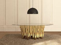 table en laiton et verre DIY Wanderlust réalisée par « Malabar Emotional Design », qui se compose d'un plateau en verre et d'une centaine de tuyaux en laiton et noyer, faisant office de pieds.