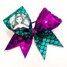 This bow combines a love for Starbucks and Disney! See Ariel and some of her friends on this purple sequins and green hologram bow! Option 1 is