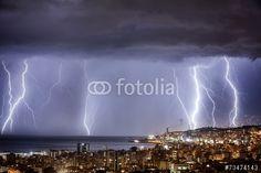 """Laden Sie das lizenzfreie Foto """"Night cityscape with strong lightning"""" von Anna Omelchenko zum günstigen Preis auf Fotolia.com herunter. Stöbern Sie in unserer Bilddatenbank und finden Sie schnell das perfekte Stockfoto für Ihr Marketing-Projekt!"""