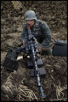 German soldier sighting a MG 34 (Maschinengewehr Modern HOAX, Photoshopped to look like an old photo.